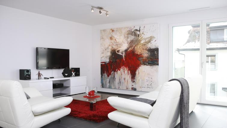 Living area at Bahnhofstrasse Apartments - Citybase Apartments