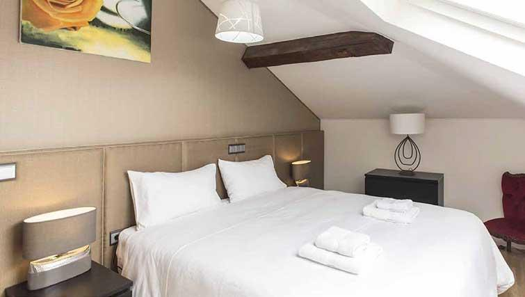 Bed at Gemma Apartment - Citybase Apartments