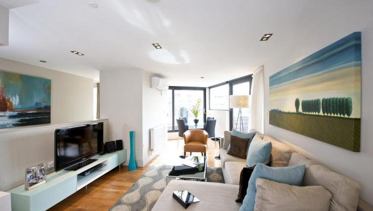 Open-plan living area at Fraser Residence City London - Citybase Apartments
