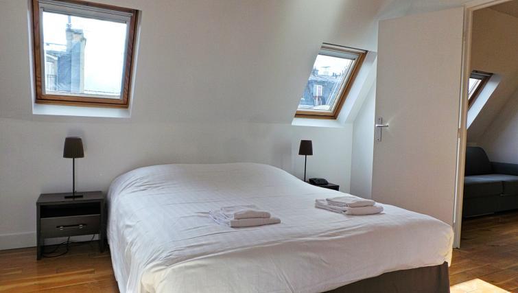 White bedroom at Apartments Du Marais - Citybase Apartments