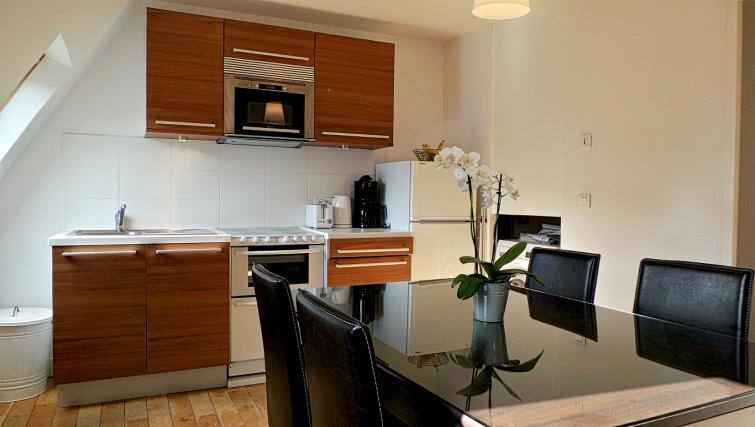 Equipped kitchen at Apartments Du Marais - Citybase Apartments