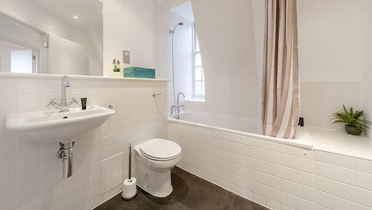 Bathroom at Groveland Court Apartments - Citybase Apartments