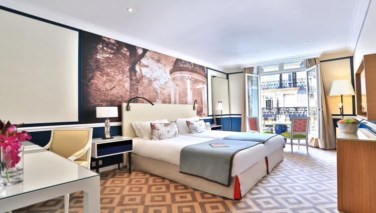 Beautiful bedroom at Fraser Suites Le Claridge Champs-Elysees - Citybase Apartments