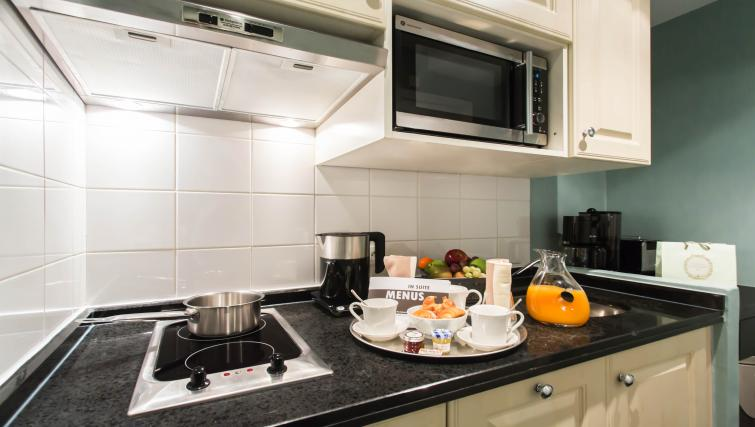 Equipped kitchen at Fraser Suites Le Claridge Champs-Elysees - Citybase Apartments