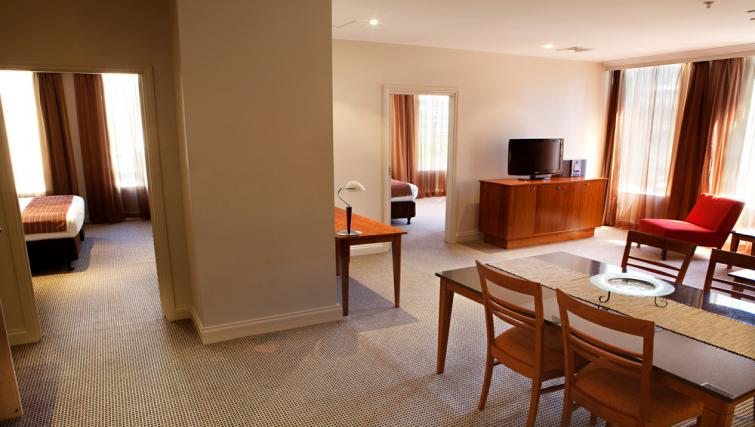 Dining area at Mantra on Little Bourke - Citybase Apartments