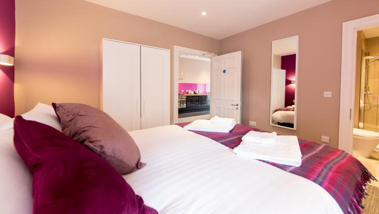 Purple bedroom at The Spires Edinburgh - Citybase Apartments