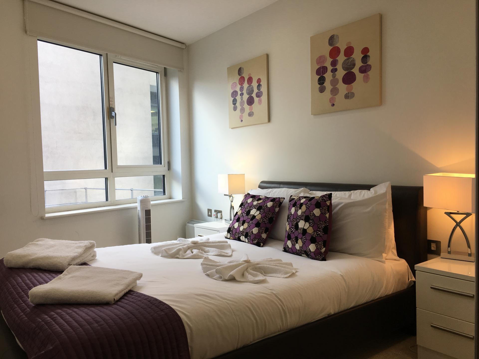Bright bedroom at Still Life Barbican - Citybase Apartments
