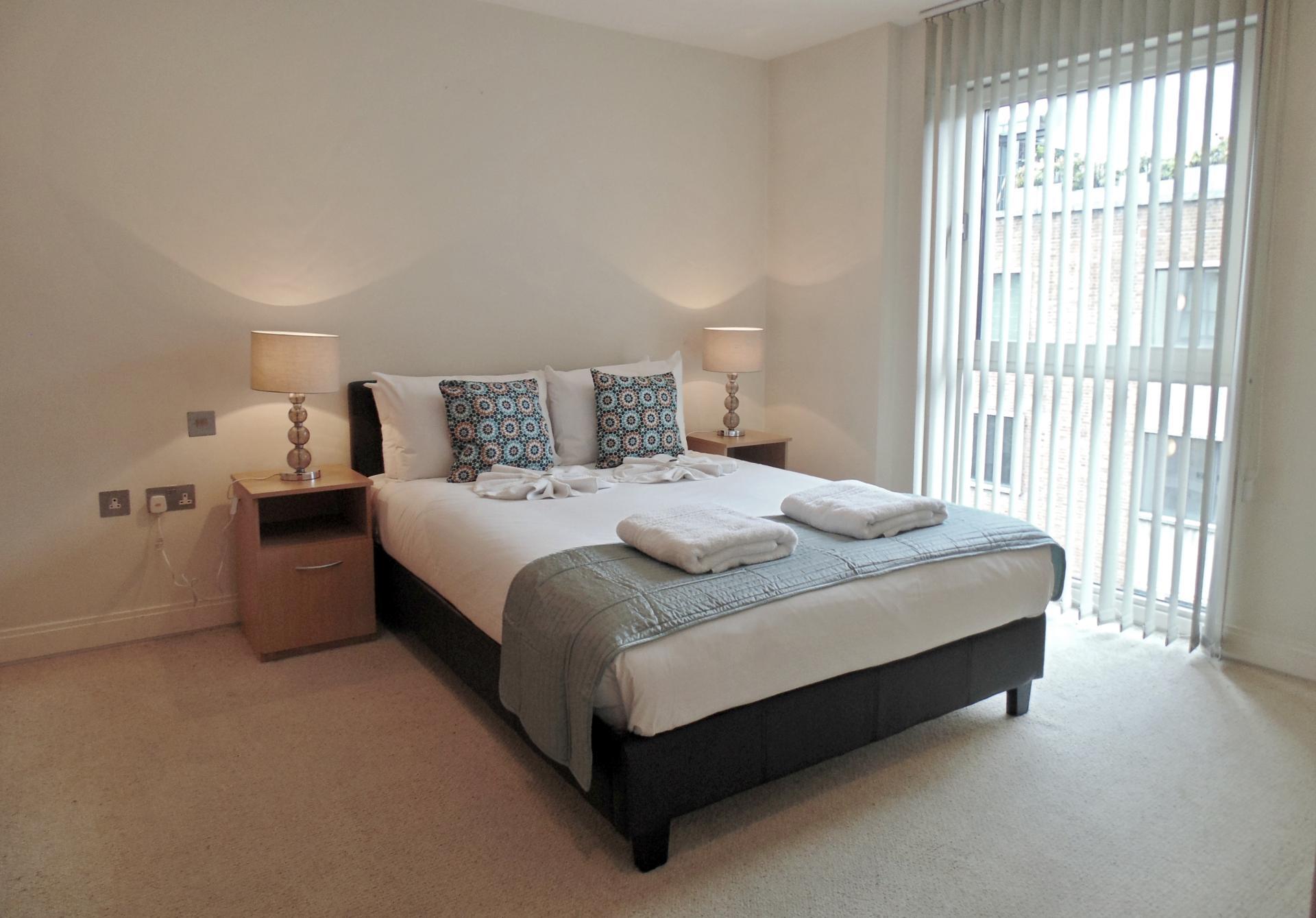 Spacious bedroom at Still Life Barbican - Citybase Apartments