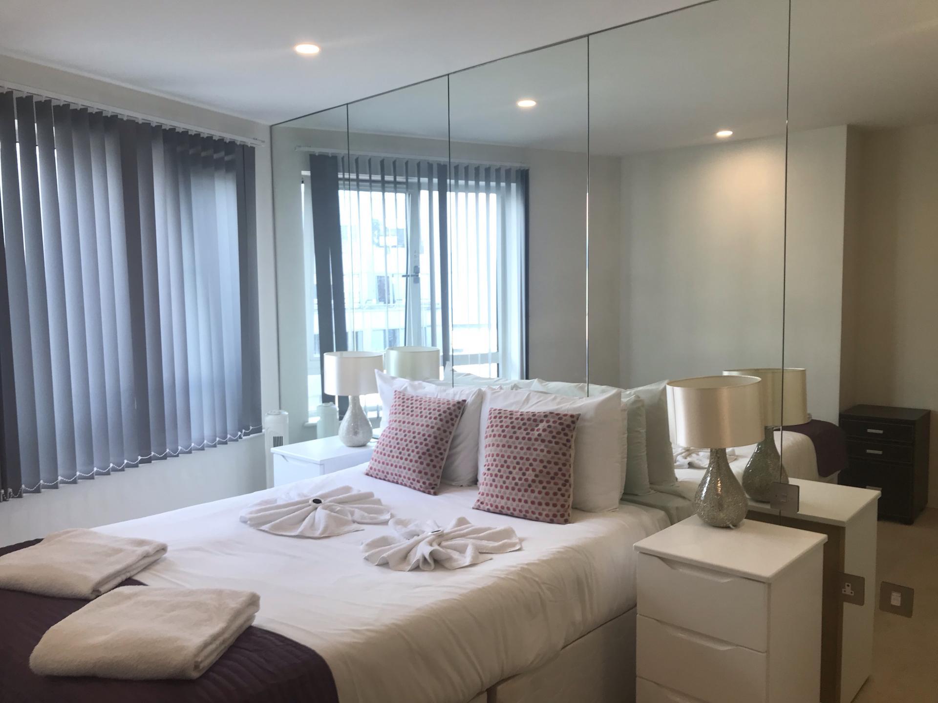 Stylish bedroom at Still Life Barbican - Citybase Apartments