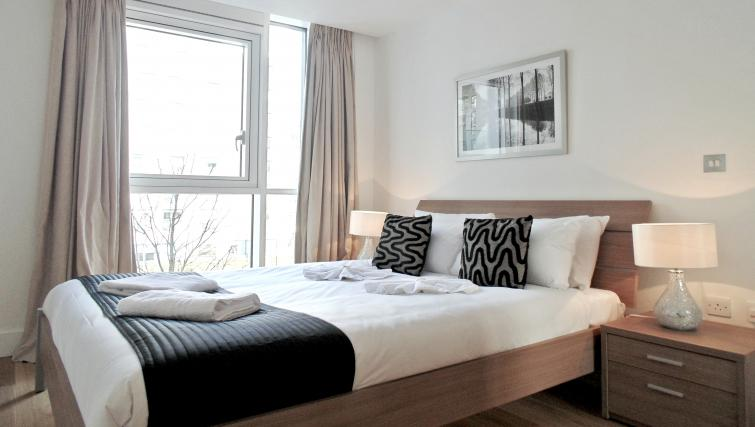 Bed at Still Life Tower Hill Deluxe - Citybase Apartments