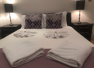Cosy bedroom at Still Life Tower Hill Deluxe - Citybase Apartments