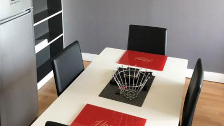 Dining table at Halo West One Apartments - Citybase Apartments