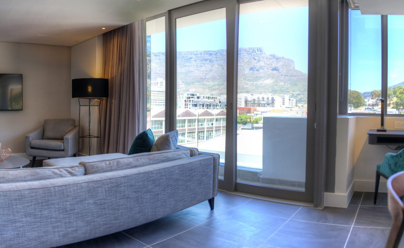 Spacious lounge at The Capital Mirage, De Waterkant, Cape Town - Citybase Apartments