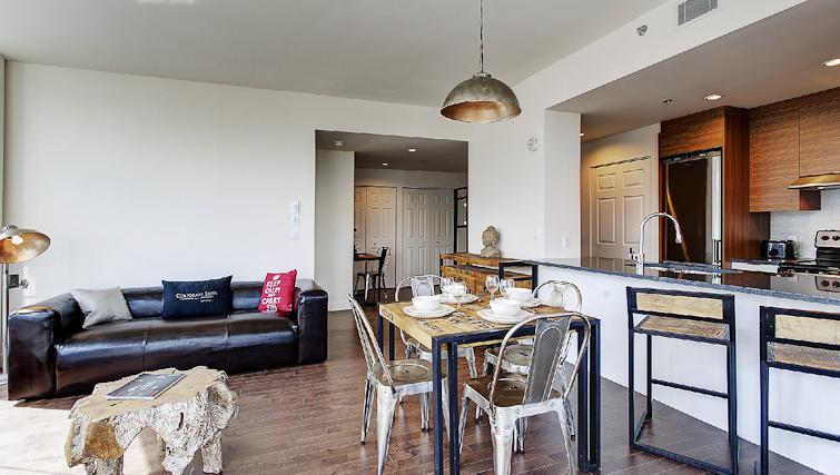 Dining area at Le V Apartments - Citybase Apartments