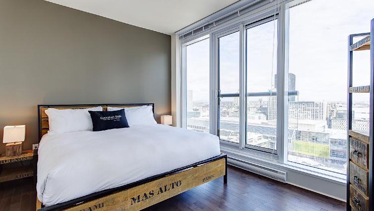 Bedroom at Le V Apartments - Citybase Apartments