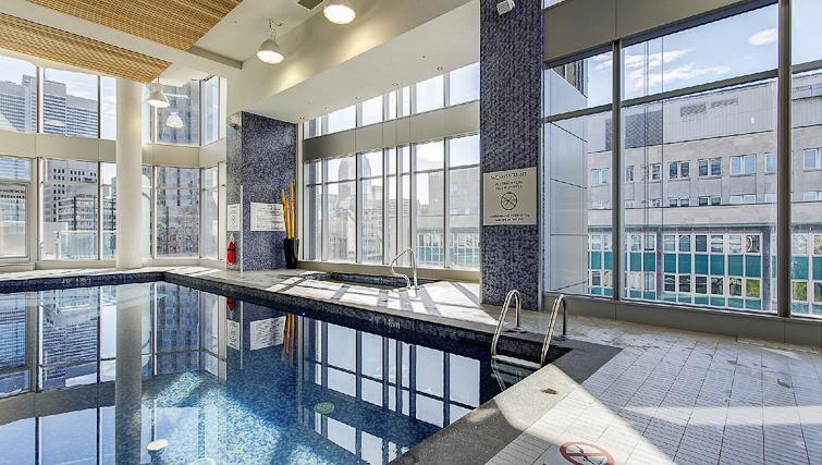 Swimming pool at Le V Apartments - Citybase Apartments