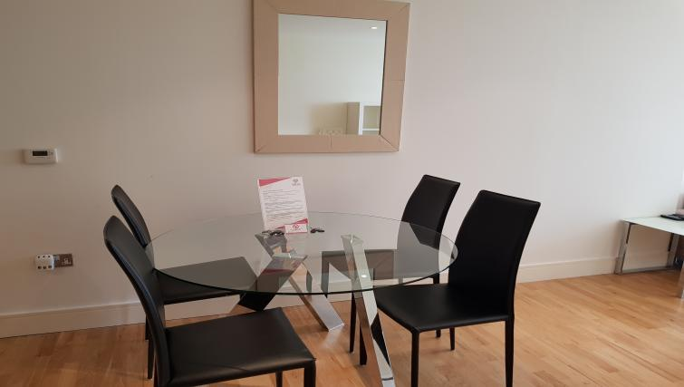 Dining table at the Still Life Canary Wharf Executive - Citybase Apartments