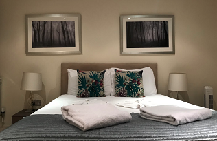 Stylish bedroom at  Still Life Canary Wharf Executive - Citybase Apartments