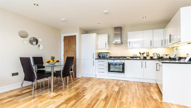 Equipped kitchen at Flying Butler Gayton Road Apartments - Citybase Apartments