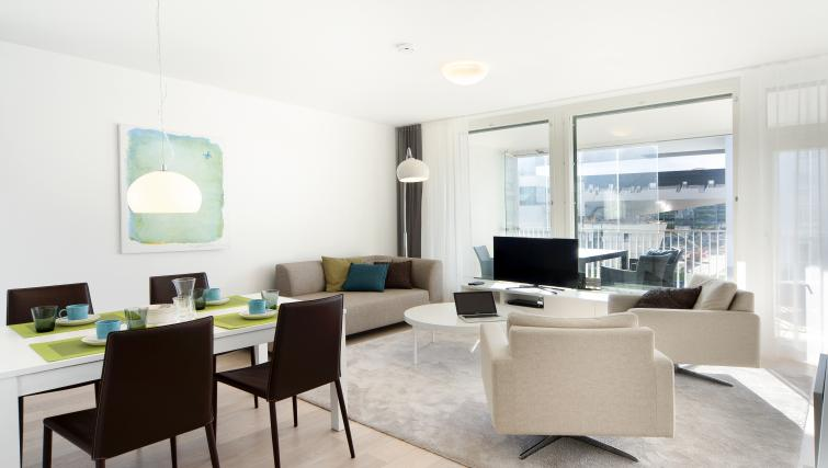 Modern living area at Aallonkoti Hotel Apartments - Citybase Apartments