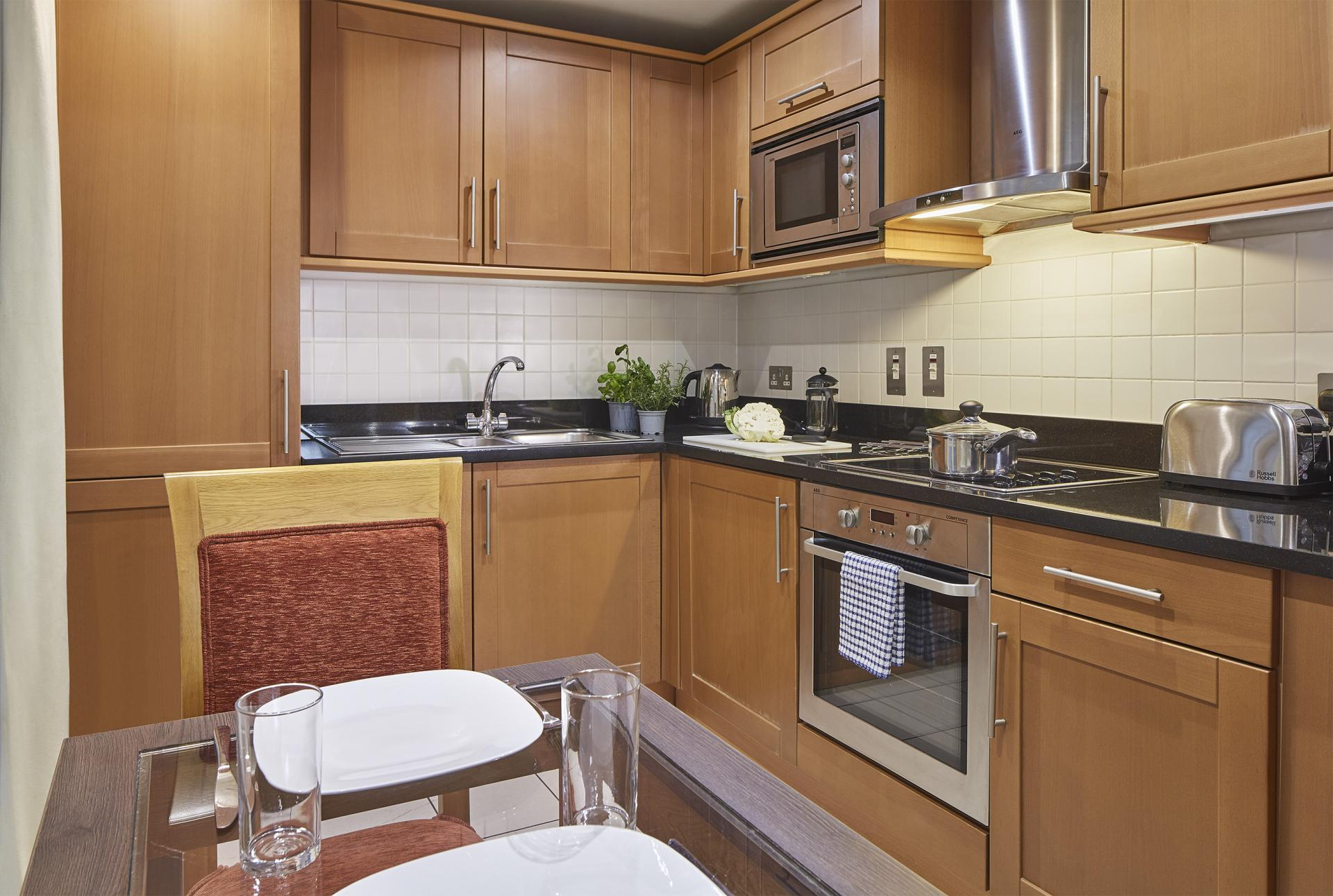 Kitchen at Queen Street St Paul's Apartments, Mansion House, London - Citybase Apartments