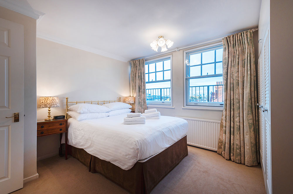 Bed at No.1 The Mansions Apartments, Earls Court, London - Citybase Apartments