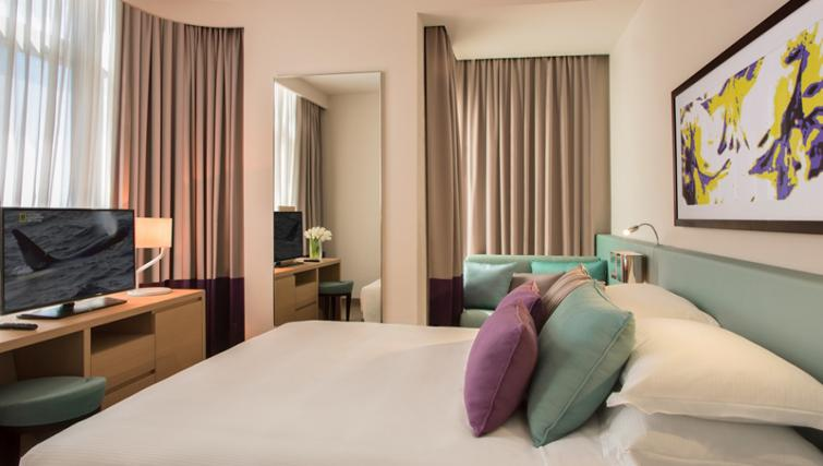 Double bed at Capital Centre Arjaan Apartments - Citybase Apartments