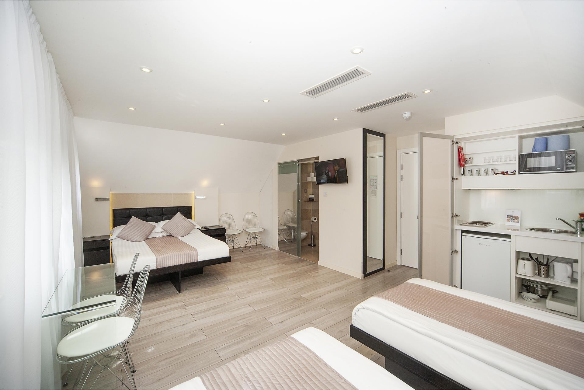 Spacious bedroom at 88 Studios Kensington - Citybase Apartments