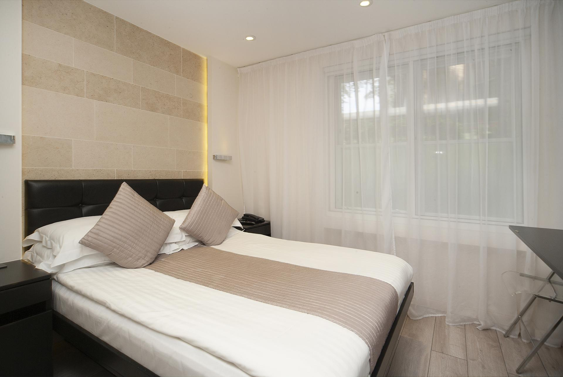 Comfortable bedroom at 88 Studios Kensington - Citybase Apartments