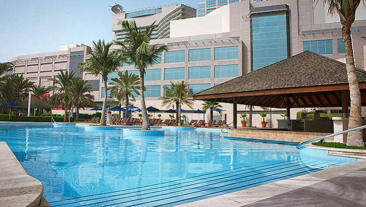 Tranquil pool at Beach Rotana All Suites - Citybase Apartments