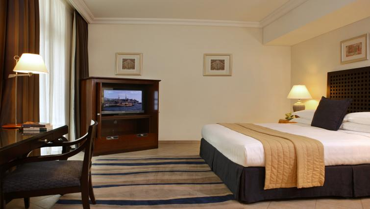 Large bed at Beach Rotana All Suites - Citybase Apartments