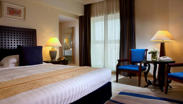 Spacious bedroom at Beach Rotana All Suites - Citybase Apartments