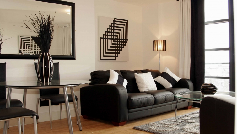 Stately living area in Friarsgate Apartments - Citybase Apartments