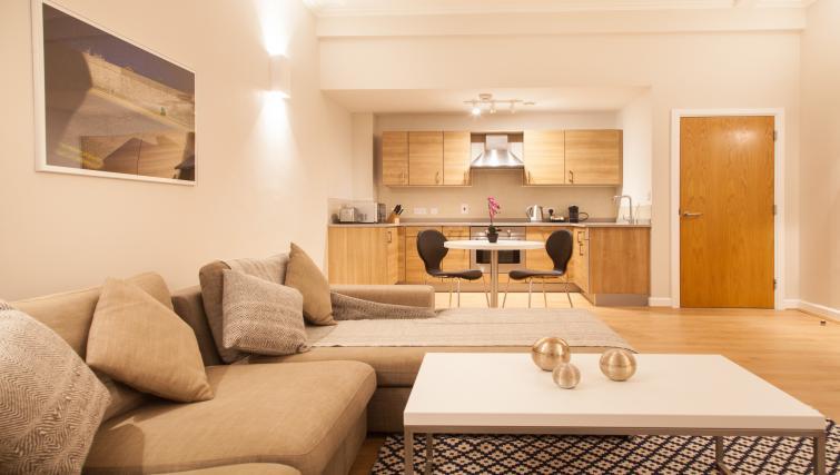 Open-plan living area at Premier Suites Plus Glasgow - Citybase Apartments
