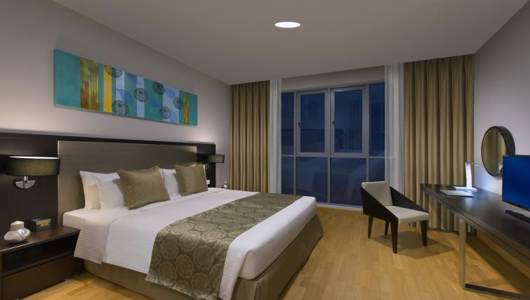 Master bedroom at Somerset Puteri Harbour Apartments - Citybase Apartments