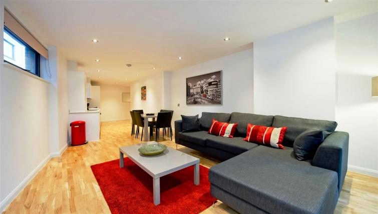 Red living room at Flying Butler London Bridge Apartments - Citybase Apartments
