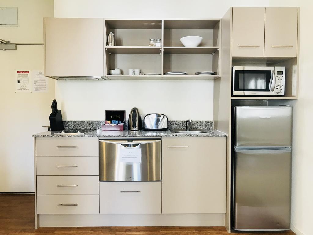 Kitchen facilities at Quest on Lambton - Citybase Apartments