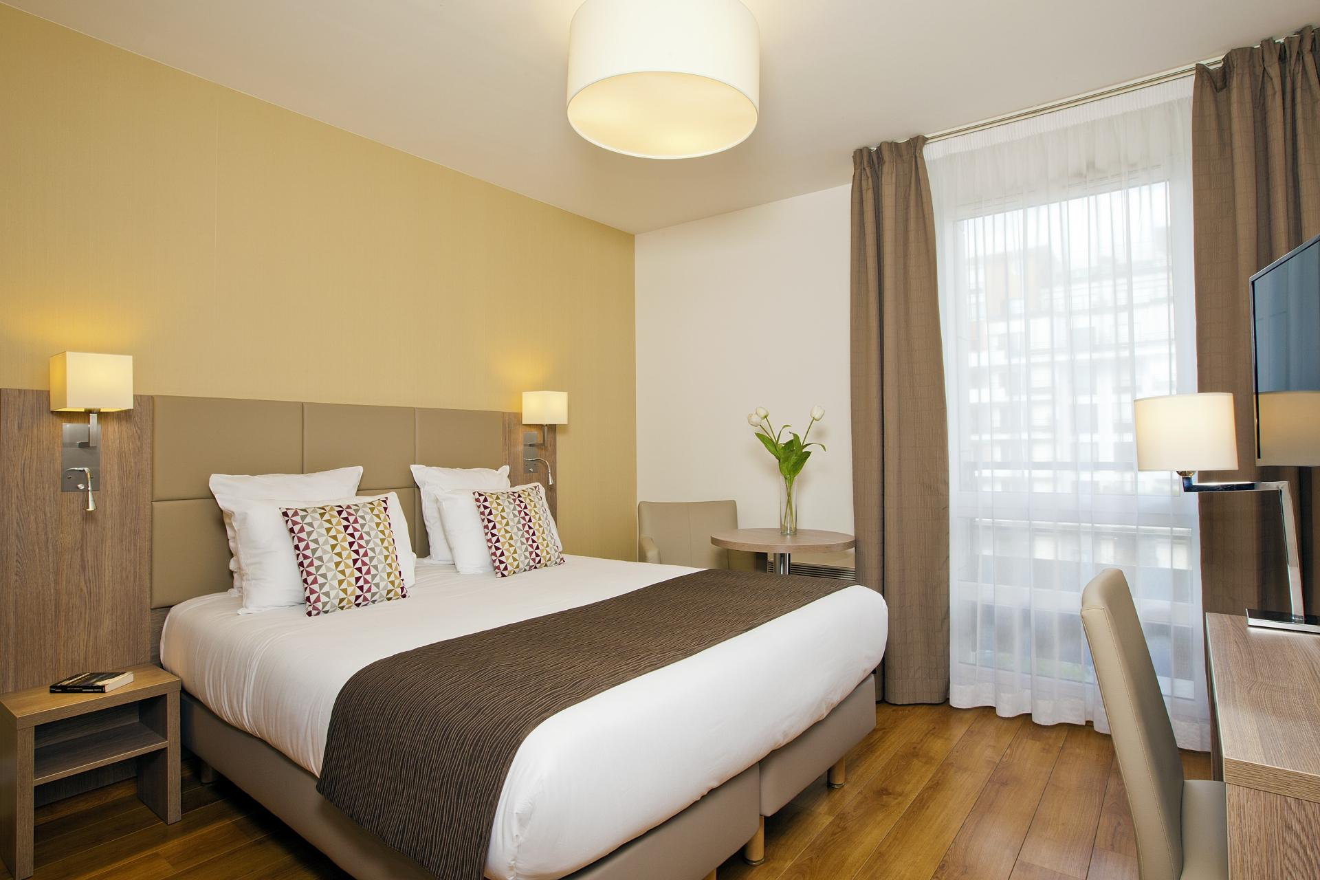 Bedroom at Residhome Bois Colombes Monceau Apartments - Citybase Apartments