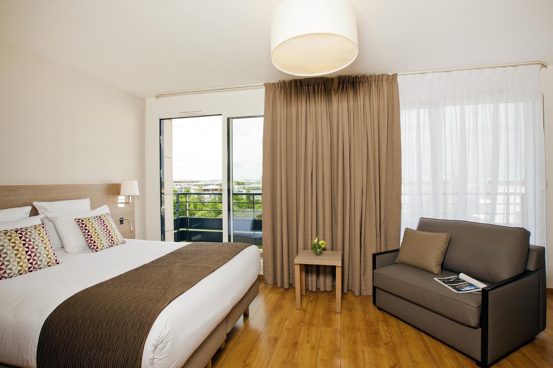 Spacious bedroom at Residhome Bois Colombes Monceau Apartments - Citybase Apartments