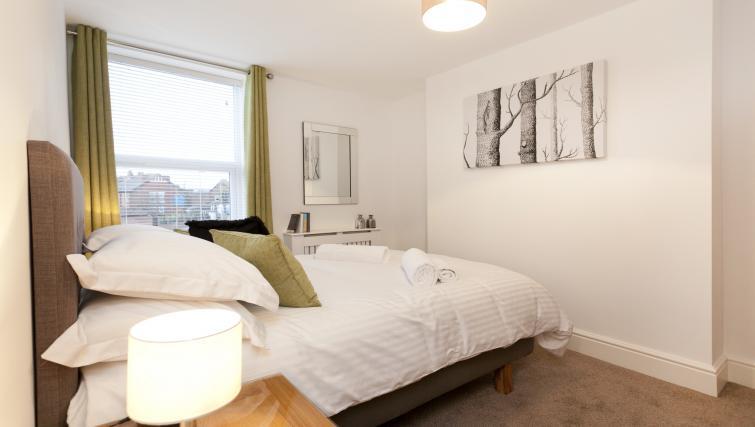 Bed at Bowling Green Courtyard Apartments - Citybase Apartments