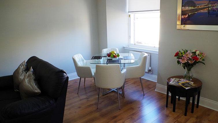 Dining table and chairs at Saint Vincent Street Apartments - Citybase Apartments