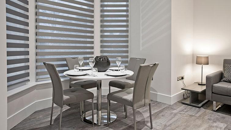 Dining area at Apple Apartments Devanha Gardens - Citybase Apartments