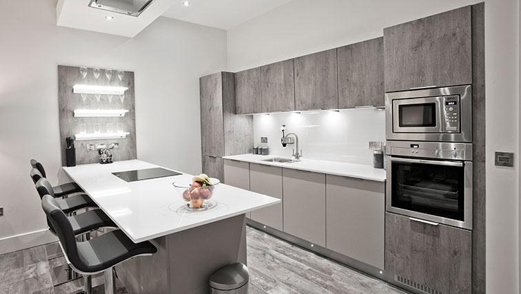 Equipped kitchen at Apple Apartments Devanha Gardens - Citybase Apartments