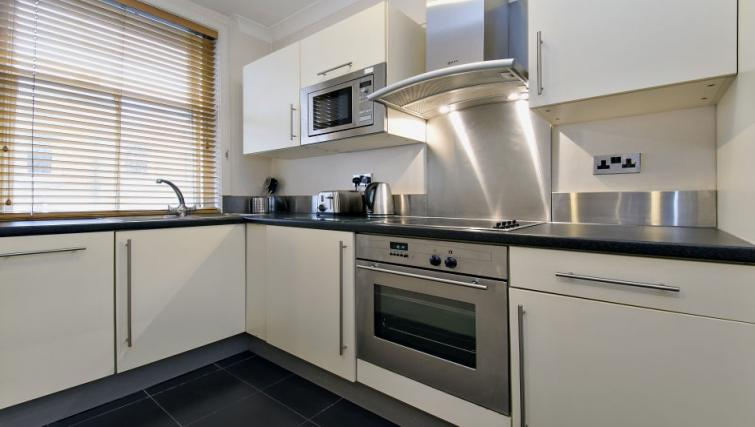 Full kitchen at 43-49 Chiltern Street Apartments - Citybase Apartments
