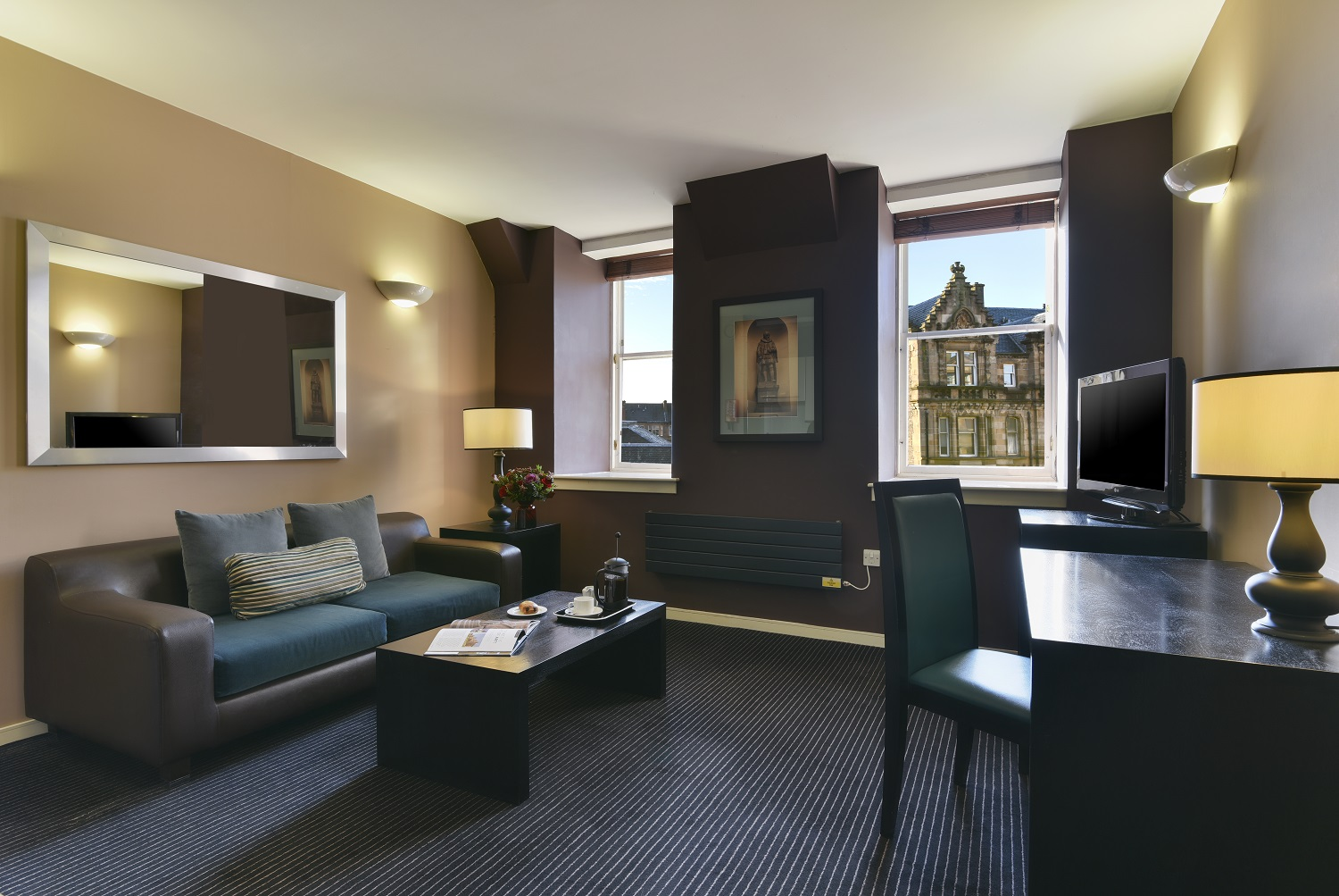 Lounge area at Fraser Suites Glasgow - Citybase Apartments