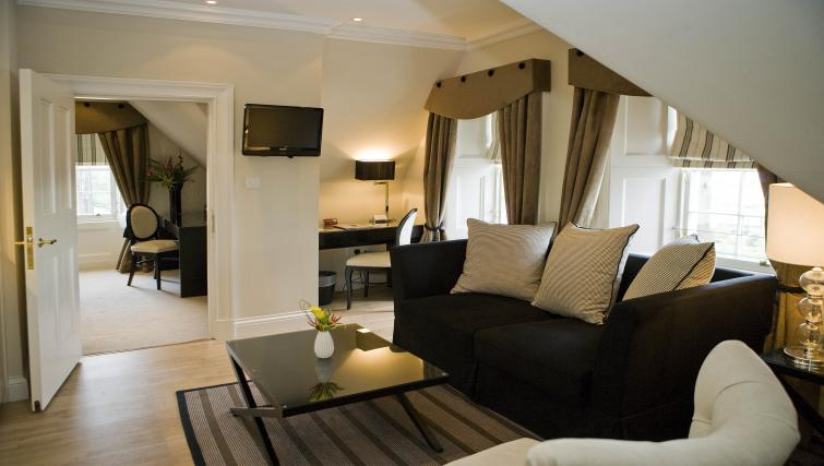 Lounge area and work desk at Fraser Suites Edinburgh - Citybase Apartments