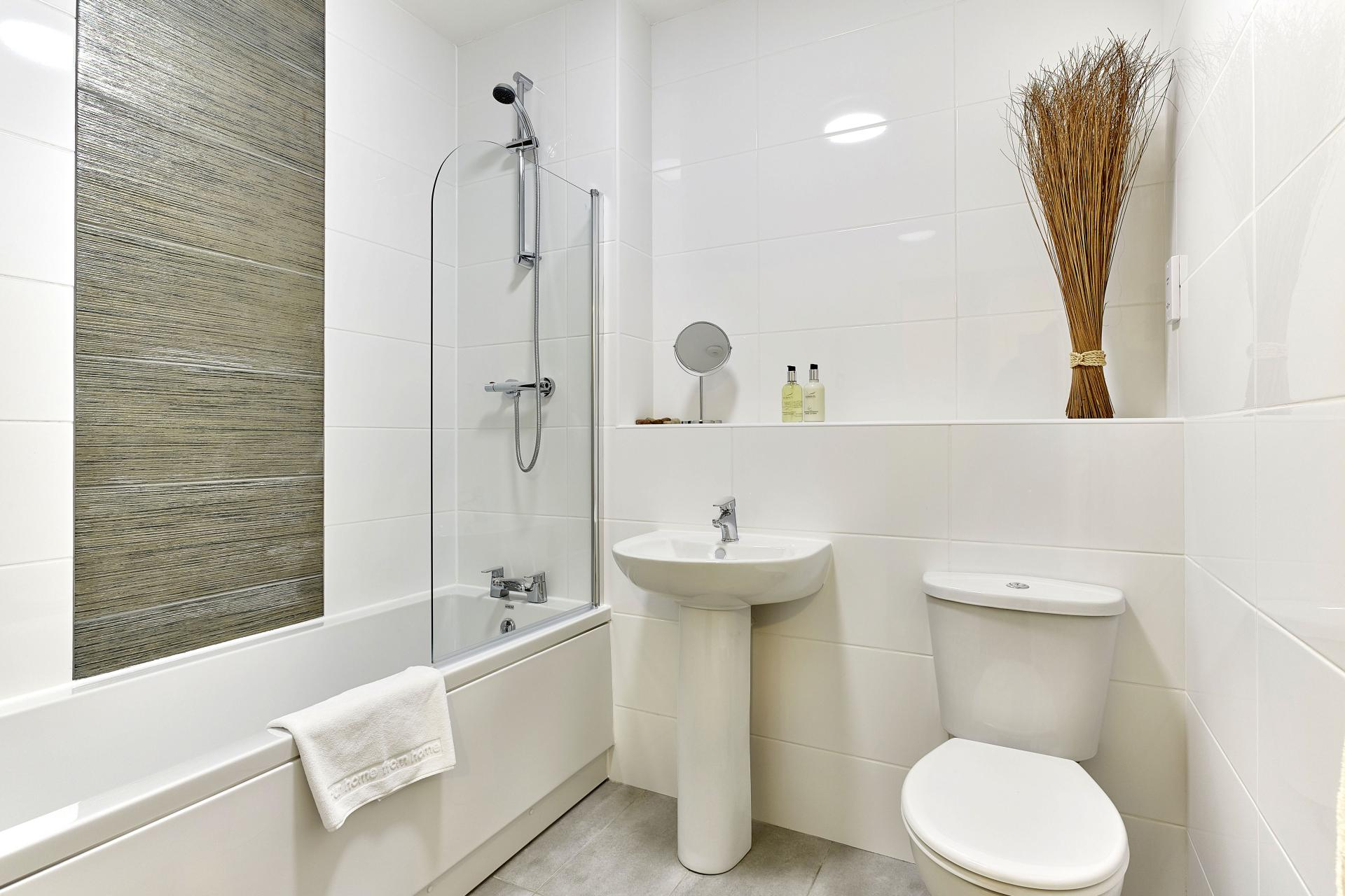 Bright bathroom at Guild House Apartments - Citybase Apartments