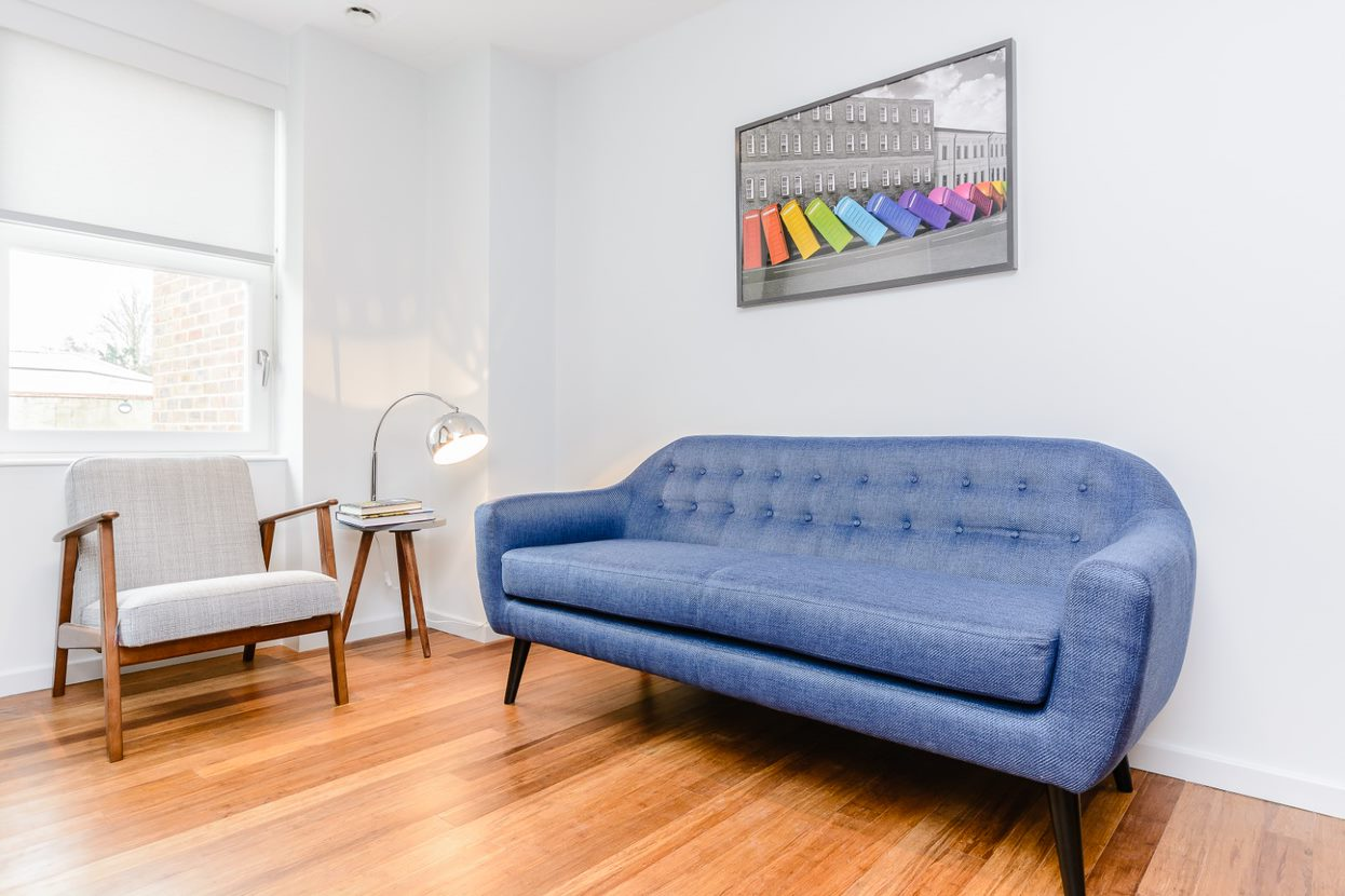 Sofa at Bed at Flying Butler Richmond Apartments - Citybase Apartments