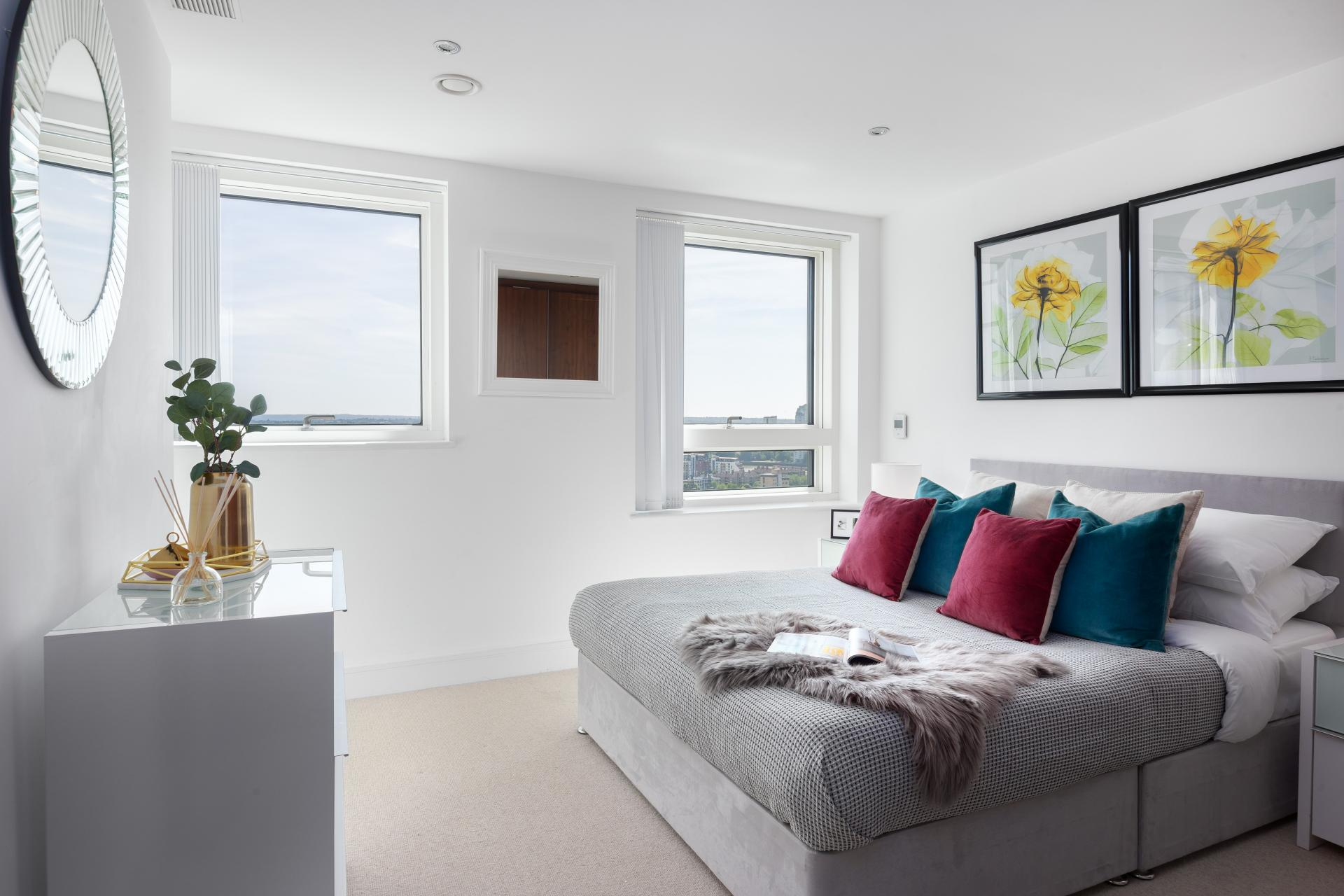 Bright bedroom at Duckman Tower Lincoln Plaza Apartments - Citybase Apartments