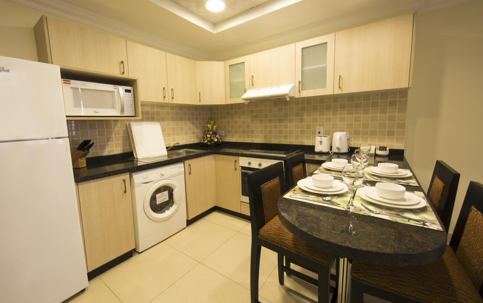 Kitchen at Ivory Grand Hotel Apartments - Citybase Apartments